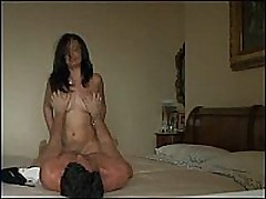 Nice-looking big-breasted girl rides her man hard