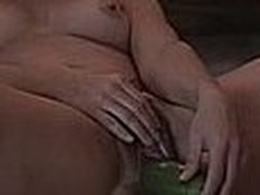 Masturbating with a cucumber