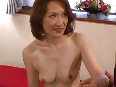 this oriental milf wears only her stockings