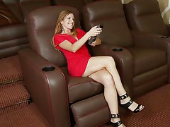 blonde doxy masturbates on an armchair