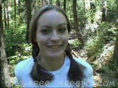 Pigtail Gal gives blow job in the forest