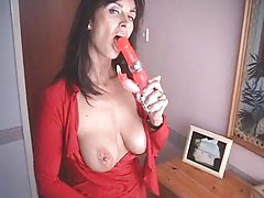 British MILF bonks herself with a pair of high heeled shoes